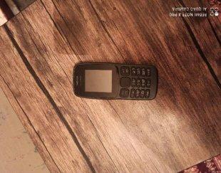 گوشی موبایل ساده ۱۰۶ و ساعت